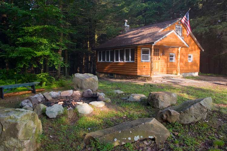 This secluded logged vacation cabin has a huge hottub, campfire and amenities. Enjoy hiking on our trails or on the 1,100 acres of pure State Game Lands that touch our property.